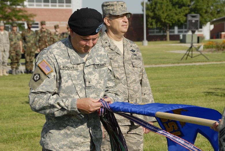 Brig. Gen. Timothy K. Kadavy, Adjutant General Nebraska,(center) pins the ninth Air Force Outstanding Unit Award streamer on the 155th Air Refueling Wing flag during a Honors Ceremony held at the Nebraska Air National Guard base on 3 August, 2008. The 155th ARW was cited for support of Homeland Defense, Operation Noble Eagle, Operation Iraqi Freedom, Environmental Protection, Compliance Inspections, Community Involvement, and Flying Safety.  (Nebraska Air National Guard photo by Master Sgt. Alan Brown)(Released)