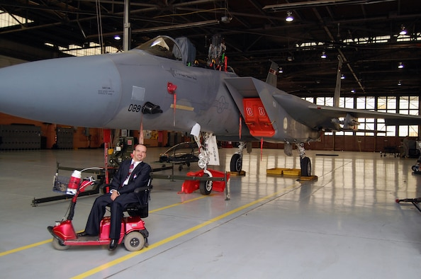"""Willie """"Wild Man"""" Deuster takes a time out from his tour of the F-15 to pose with the aircraft.  Deuster was the guest for the Brown Bag Speaker Series May 3."""