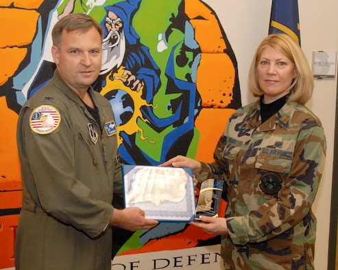 SALT LAKE CITY - Maj. Mary Enges of the 101st Information Warfare Flight is presented the Outstanding Air Force Information Operations Award Air Reserve Component Field Grade Officer of the Year, Level II by Col. Brian Dravis, deputy director of operations at the National Guard Bureau in Washington, D.C. during the June 2007 UTA drill. (USAF photo by Tech. Sgt. Mike Evans)
