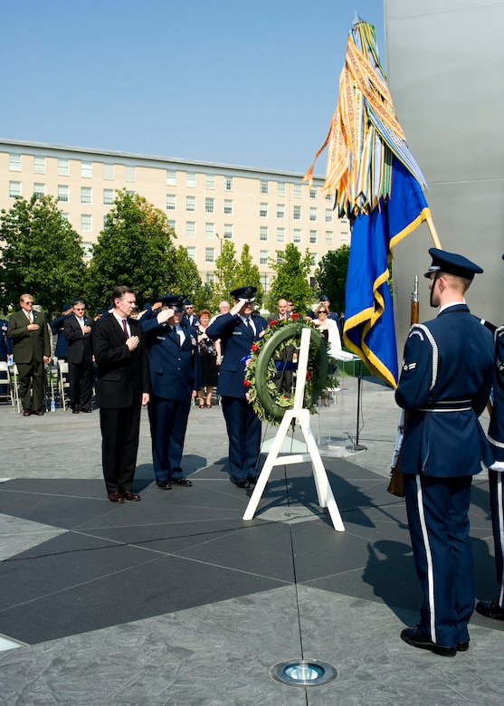 In observance of the 60th Anniversary of the Air Force Office of Special Investigations a wreath is placed at the Air Force Memorial Aug. 1. Saluting the wreath in a moment of tribute to the men and women of AFOSI are (l to r) Mr. Douglas Thomas, AFOSI Executive Director, Command Chief Master Sgt. Chris Redmond, AFOSI Command Chief and Brig. Gen. Dana Simmons, AFOSI commander. (U.S. Air Force photo/Mike Hastings)