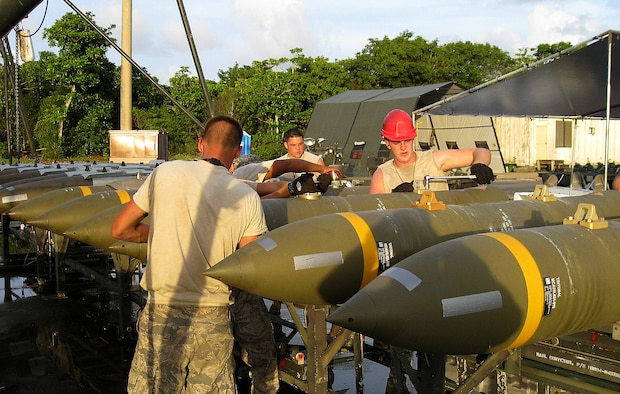Airmen from the 36th Munitions Squadron buildup the Joint Direct Attack Munitions on the Munitions Assembly Conveyor at the at 4E-1 Pad during the Ammunition Production Exercise (CAPEX) that took place here July 28 through Aug. 2. The CAPEX exercise provided unit training in mass production of non-nuclear war reserve munitions and training in mass munitions assembly in support of aircraft generation. (Courtsey photo)