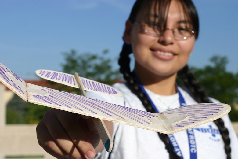 Air Force Junior ROTC Cadet Rosa Lopez from Texas shows off her team's handmade glider during the Air Force Junior ROTC Aerospace and Technology Honor Camp July 31 at Albuquerque, N.M. More than 450 cadets from Junior ROTC units worldwide participated in a total of eight camps with 54 students each - half at Albuquerque. and half at Norman, Okla., and Tinker Air Force Base. Currently, there are more than 100,000 cadets in the Air Force Junior ROTC program worldwide. (U.S. Air Force photo/Staff Sgt. Jason Lake)