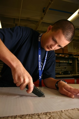 Air Force Junior ROTC Cadet Thomas Murphy from California carves out the frame of his team's rocket car July 29 during the 2008 Air Force Junior ROTC Aerospace and Technology Honor Camp rocket car contest at Albuquerque, N.M.  More than 450 cadets from Junior ROTC units worldwide participated in a total of eight camps with 54 students each - half at Albuquerque and half at Norman, Okla., and Tinker AFB. (U.S. Air Force photo/Staff Sgt. Jason Lake)
