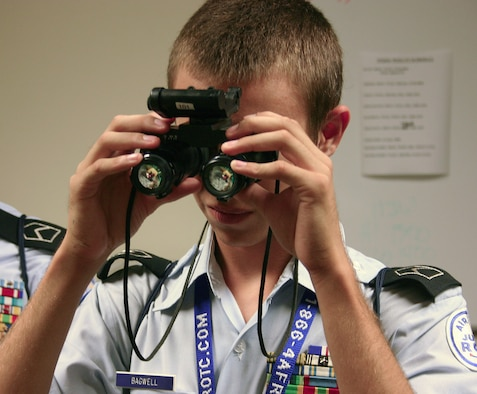 Junior ROTC Cadet Nicolas Bagwell from Texas tries out a pair of night vision goggles during a visit to the 58th Special Operations Wing at Kirtland Air Force Base, N.M . More than 50 cadets from 20 states nationwide visited the 58th SOW as part of the 2008 Air Force Junior ROTC Aerospace and Technology Honor Camp held July 26-31. (U.S. Air Force photo/Staff Sgt. Jason Lake)
