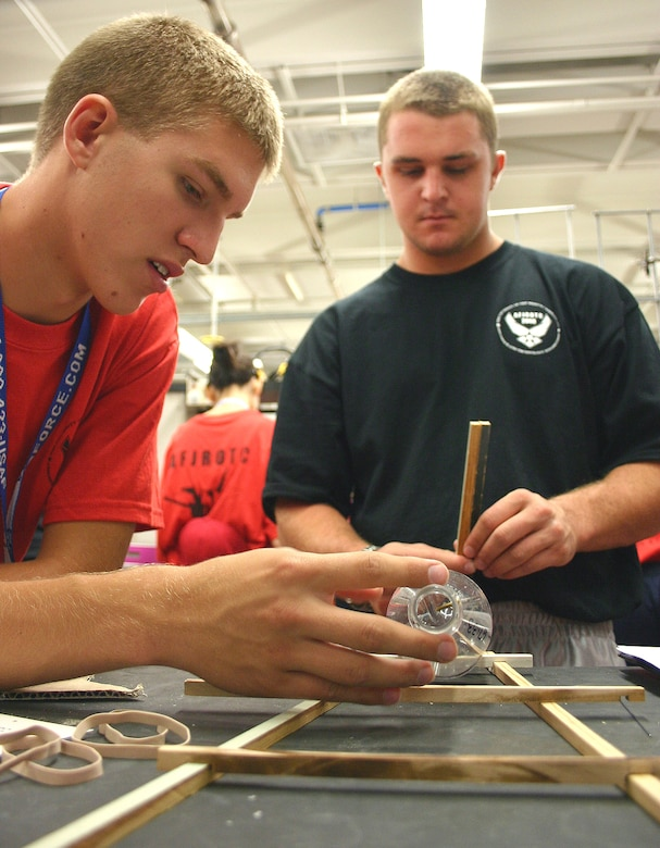 Air Force Junior ROTC Cadets Ryan Moran from South Carolina and John Coleman from California piece together the framework of their rocket car July 29 during the 2008 Air Force Junior ROTC Aerospace and Technology Honor Camp at Albuquerque, N.M. (U.S. Air Force photo/Staff Sgt. Jason Lake)