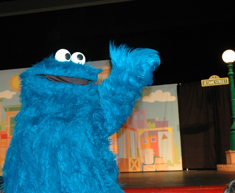 Cookie Monster waves good-bye to the children at the end of the show at North Ridge High School in Layton, August 1.  (U.S. photo by Airman 1st Class Robby Hedrick)