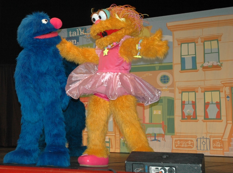 A muppet sings to Grover during the live performance at North Ridge High School in Layton, August 1.  (U.S. photo by Airman 1st Class Robby Hedrick)