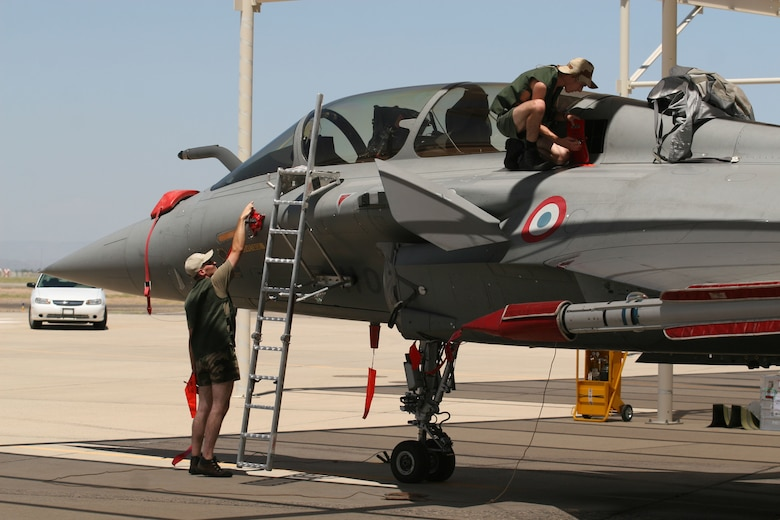 Two French air force maintainers work on their Rafale aircraft during visit to Luke AFB, July 29. Four aircraft and more than 100 personnel deployed for the first time on U.S. soil to participate in a joint exercise at Luke. (Photo courtesy of Pete Pallagi/Daily News-Sun)