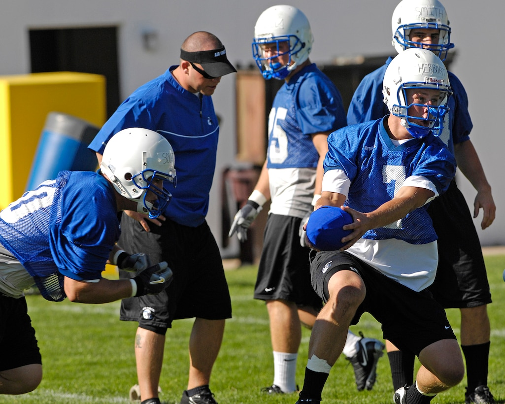 Quarterback Cadet 2nd Class Eric Herbort practices handoffs with fullback Cadet 3rd Class Ryan Southworth as the Falcons practice in preseason camp July 31 at the U.S. Air Force Academy in Colorado. (U.S. Air Force photo/Mike Kaplan)