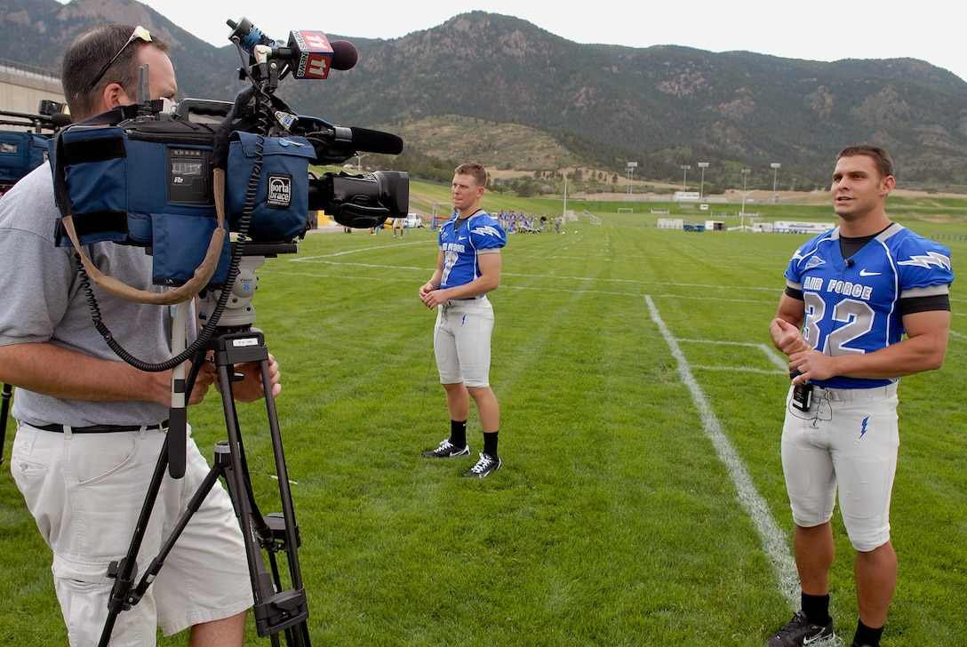 Outside linebacker Cadet 1st Class Hunter Altman (32) and quarterback Cadet 2nd Class Eric Herbort (7) talk to the media July 30 at the U.S. Air Force Academy in Colorado. (U.S. Air Force photo/Mike Kaplan)