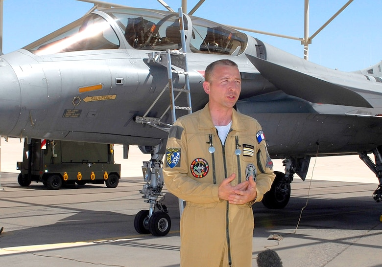 Lt. Col. Fabrice Granclaudon, French air force squadron commander, stands in front of a French Rafale aircraft while being interviewed by TF1 (French media) at Luke AFB, July 28. Four Rafale aircraft and more than 100 French airmen deployed for the first time on U.S. soil for an exercise July 28-Aug8 at Luke. (U.S. Air Force photo by TSgt. Nabor)