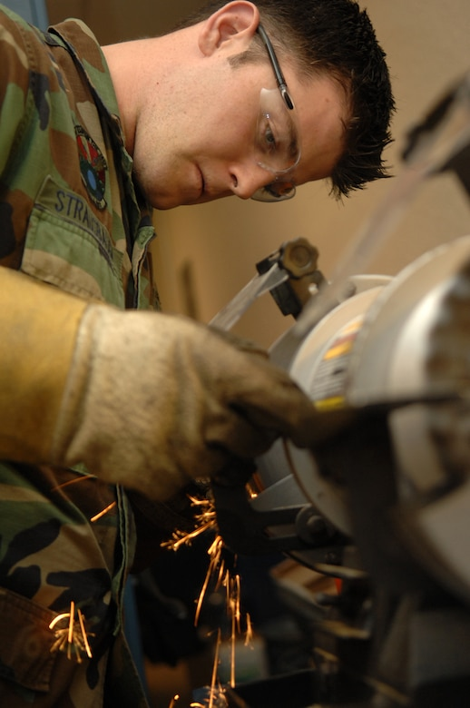 Senior Airman Beau Strausbaugh from the 755th Aircraft Maintenance Squadron here, grinds a tool to remove rust July 10. (U.S. Air Force photo/Airman 1st Class Noah R. Johnson)