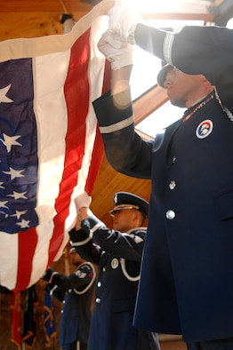 (From right) Airman 1st Class Ray Wahl, Staff Sgt. Daniel Chin and Staff Sgt. Ruben TrejoSanchez, Ellsworth Air Force Base Honor Guard members, fold a flag before a funeral service held at the Black Hills National Cemetery, July 31. The service was held for a retired Air Force master sergeant. (U.S. Air Force photo/Senior Airman Marc I. Lane)(Released)