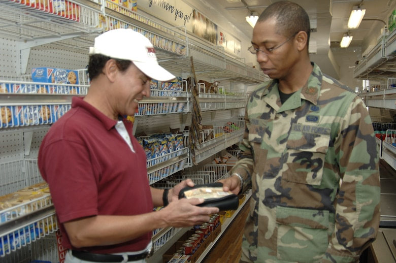 Roberto Zapata, Army & Air Force Exchange Service associate, answers questions from Maj. Patrick Dyson, Task Force New Horizons staff judge advocate, Aug. 6.  AAFES is supporting New Horizons 2008 - Peru with a tactical field exchange so that troops can purchase items they need and want over the course of the three month humanitarian mission.  (U.S. Air Force photo by Capt. David Tomiyama)