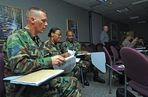 Tech. Sgt.'s Glen Pearson (far left), Alicia Bowens and Milton Willhight prepare to give a group presentation while attending a Noncommissioned Officer Leadership Development Program course at McConnell Air Force Base, Kan. The course, designed to help mid-level NCOs develop leadership, began on Aug. 4 and is scheduled to end on Aug. 15. Sergeant's Pearson and Willhight are assigned to the 931st Aircraft Maintenance Squadron.  Sergeant Bowens is assigned to the 931st Communication and Information Systems Flight.  (U.S. Air Force Photo/Tech. Sgt. Jason Schaap)