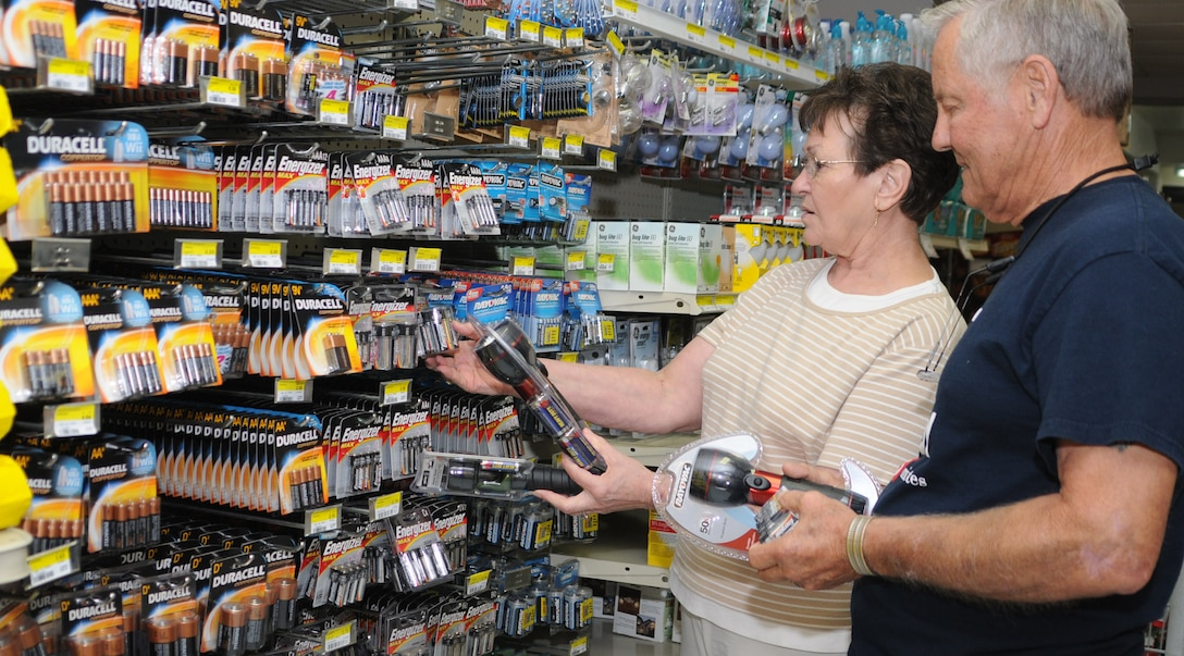Ollie and Jim Cole from Mobile, Ala., shop for flashlights and batteries for their disaster preparation kit, Friday.  Mr. Cole is a retired technical sergeant.  (U.S. Air Force photo by Kemberly Groue)