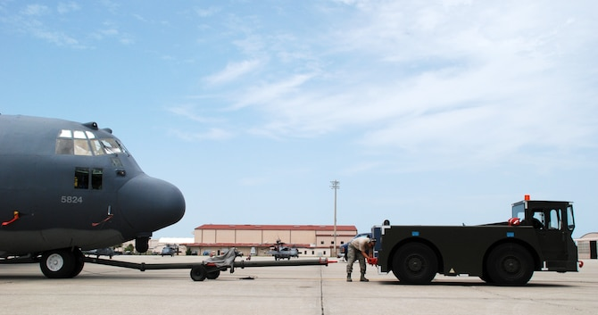 An HC-130 Hercules is towed back onto the flightline at Patrick Air Force Base after 920th Rescue Wing maintainers completed servicing a strut on the aircraft.(U.S. Air Force photo/Staff Sgt. Heather Kelly)
