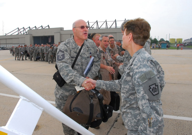 Maj. Gen. Jessica L. Wright, Adjutant General of the Pa. National Guard, bids farewell to Senior Master Sgt. Frank L. Rabena, Jr., 111th Aircraft Maintenance Sq. and approx. 160 guardsmen heading to Afghanistan from the 111th Fighter Wing, Willow Grove Air Reserve Station, Pa. July 27 in support of the continuing war on terrorism.