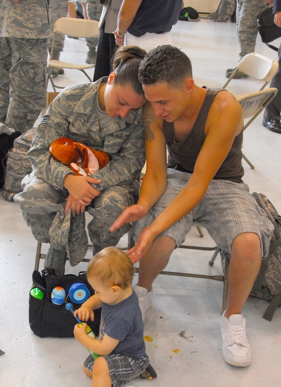 Senior Airman Megan T. Cobb, 111th Logistics Readiness Sq. spends her last moments with family before deploying with 160 guardsmen to Afghanistan from the 111th Fighter Wing, Pa. Air National Guard, Willow Grove Air Reserve Station, Pa. July 27 to support the continuing war on terrorism.