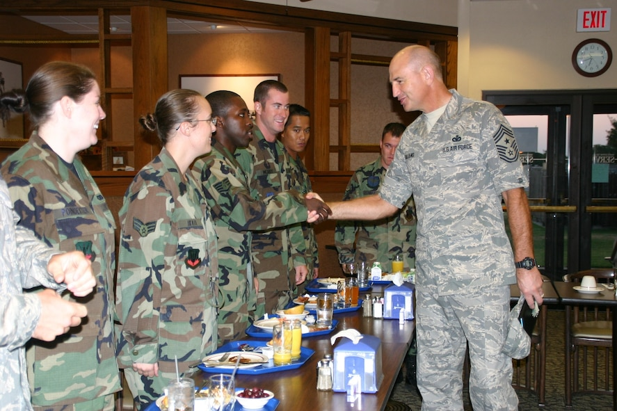 Chief Master Sgt. Stephen C. Sullens, Command Chief, Air Combat Command greets members of the 552nd Air Control Wing at an Airmen's Breakfast at Vanwey Dining Facility during his visit. Chief Sullens discussed various topics with the Airmen including the new military uniform, physical fitness, deployments and sponsorship. Photo by 2nd Lt. Kinder Blacke.