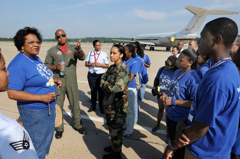 """Captain Rich """"Sheriff"""" Peace, from the 100th Fighter Squadron, Montgomery, Alabama gives an F-16 briefing to a group of adults and children from the Summer Transportation Institute, Cheney University, Pa. The 111th Fighter Wing hosted Tuskegee Airman Youth Day on Saturday July 19th.  Young men and women from Greater Philadelphia and Delaware came to the Willow Grove Air Reserve Station to meet Tuskegee Airmen and see up close aircraft such as an A-10, F-16, T-6A and P-3."""