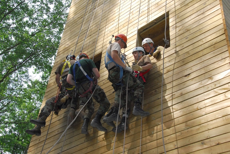 Tech. Sgt. Matthew P. Youngers and Staff Sgt. Matthew C. Haas, both of the 111th Maintenance Sq., Pa. Air National Guard, conduct a one person rescue called a 'pick off' with Team Commanders Course students at the Hawk Mountain Ranger School in Kempton, Pa. on July 17.