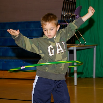 Michael Ciardelli, 6, shows off his skills on the hula hoop during a circuit class for 5- and 6-year olds at the RAF Mildenhall Youth Center Aug. 1. The 100th Force Support Squadron put together the mini-circuit class to provide extra ways to keep children entertained. (U.S. Air Force photo by Karen Abeyasekere)