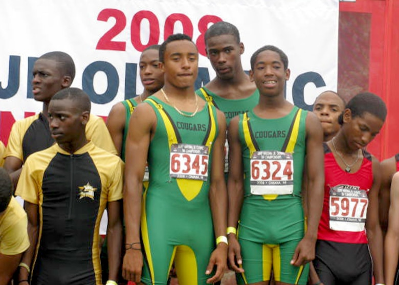 "Ricardo ""Rico"" Wright, II (#6345), son of Master Sgt. Ricardo Wright, 61st Communications Squadron, and his teammates from the SoCal Cougars stand on the first place podium as they wait to receive their Gold medals. The team ran the 4 x 800M relay at 8:10 seconds, the fastest time in the nation for intermediate boys ages 15-16 during the USATF National Junior Olympics Outdoor Track and Field Championships held in Omaha, Neb., July 22-27.  (Courtesy photo)"