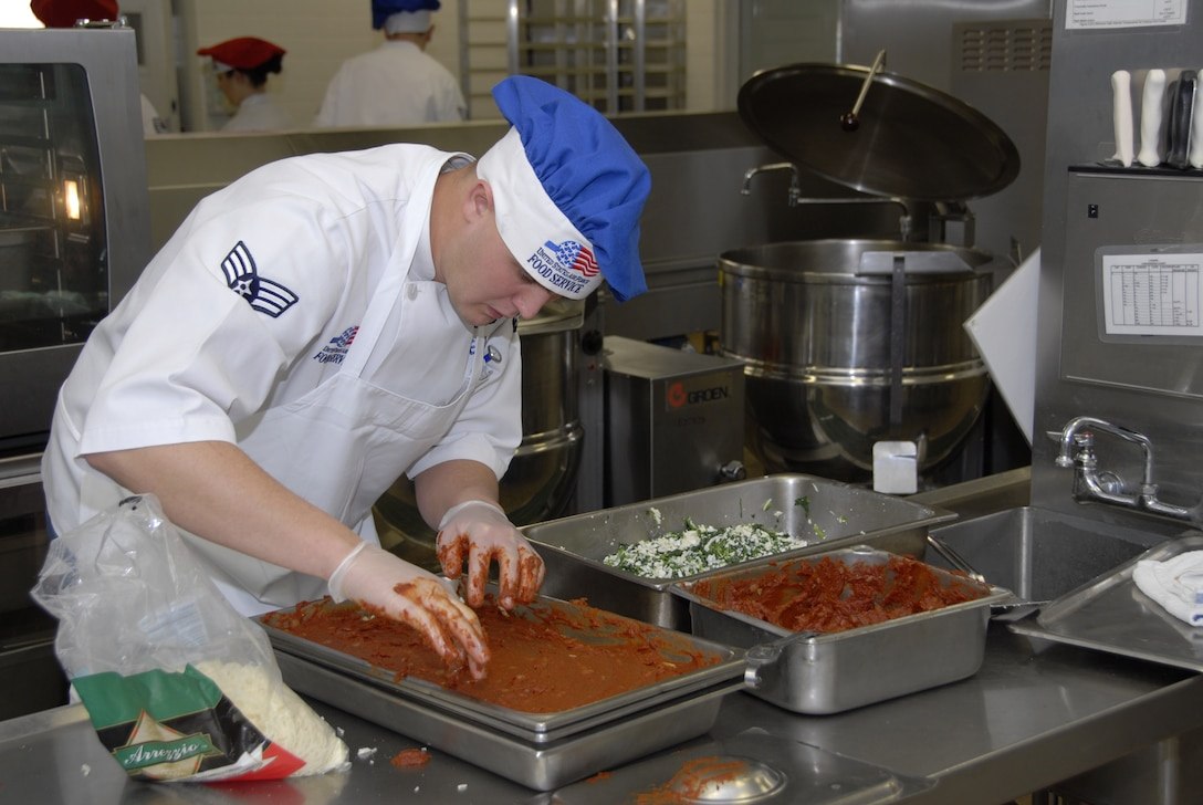 Senior Airman Michael Wellman puts the final touches on a sheet cake at the Nebraska Air National Guard dining facility.The 155th Service Flight, which runs the dining facility, was recently named the 2008 Air National Guard Senior Master Sgt. Kenneth W. Disney Food Service Excellence Award winner. (Photo by Master Sgt. Alan Brown, Nebraska Air National Guard.)