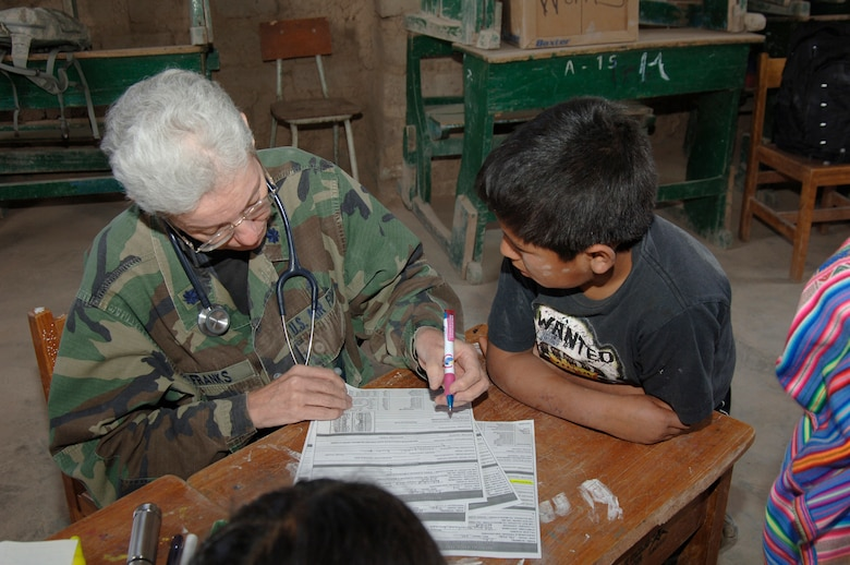 Dr. (Lt. Col.) Dain Franks, a doctor from the 433rd Medical Group at Lackland AFB, Texas, performs a medical assesment on a Peruvian boy, Aug. 1, during a medical readiness training exercise in Mollepata, Peru.  The exercise is one of nine supporting New Horizons - Peru 2008, a U.S. and Peruvian effort to provide humanitarian aid to the people of Ayacucho, Peru. (U.S. Air Force photo/1st Lt. Mary Pekas)