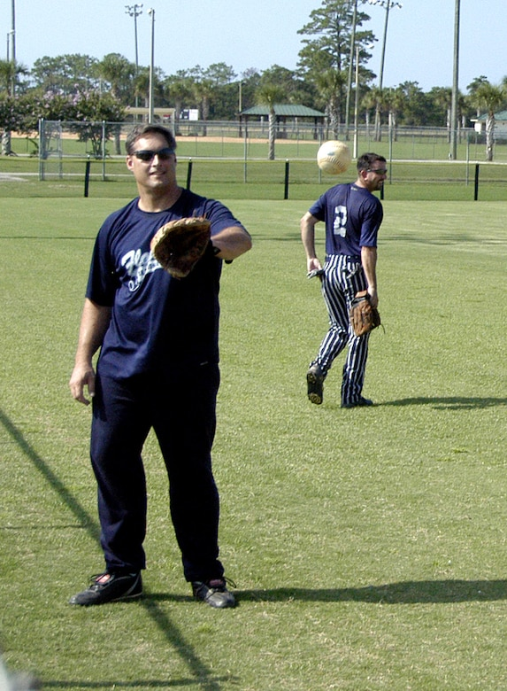 Navy CAPT (Ret.) David Fuhrmann warms up by playing catch will another member of the Florida Air National Guard team at this years 43rd Annual Air National Guard Softball Tournament. (Air Force photo by 1st Lt Jared Scott)