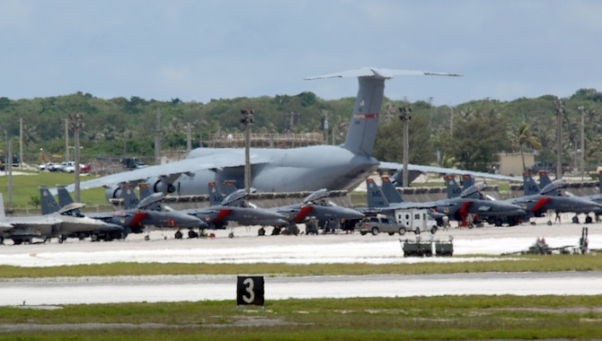 ANDERSEN AIR FORCE BASE, Guam - Air Force fighters and cargo aircraft occupy the flightline here July 29. The aircraft, deployed from several Air Force bases, are here to promote regional security and stability through three main focus areas: a continuous forward presence; a robust international exercise and training program; and significant joint military training exercises.  By maintaining a continuous forward presence and conducting joint exercises, the Pacific Air Force is able to foster improved relations and interoperability with its regional friends and allies. (U.S. Air Force photo by Airman 1St Class Cory Todd)