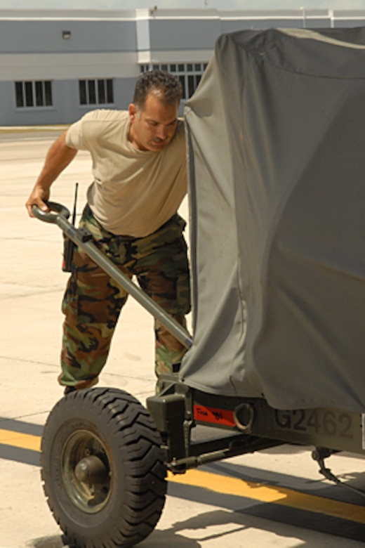 Master Sgt. Carl Shaffer of the 123rd Maintenance Squadron positions ground equipment to load onto a C-130 aircraft during the wing's successful airlift support of Southern Command operations. (Tech. Sgt. Diane Stinnett/KyANG)