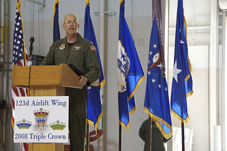 Col. Mark Kraus, commander of the 123rd Airlift Wing, praised unit members for their dedication to excellence during a commander's call June 8 in the base Fuel Cell Hangar. (Capt. Dale Greer/KyANG)