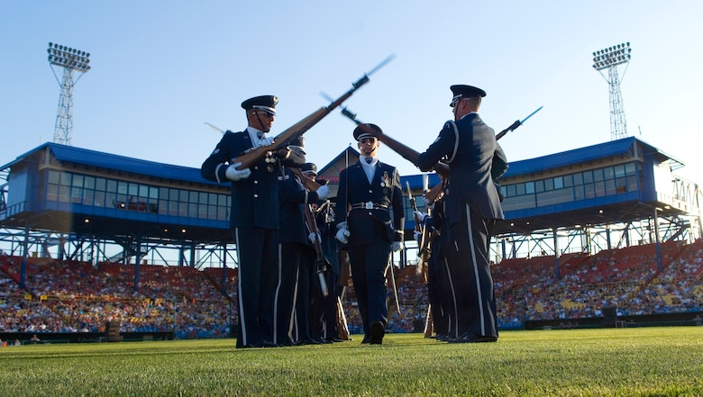 The Air Force Honor Guard drill team performs for approximately 10,000 spectators during the opening ceremonies of Air Force Week in the Heartland Aug. 9 at Rosenblatt Stadium in Omaha, Neb. The week is designed to broaden awareness of the Air Force's role in the war on terrorism and strengthen support for Airmen serving worldwide in defense of freedom. (U.S. Air Force photo/Staff Sgt. Bennie J. Davis III)