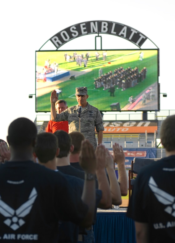 Gen. Kevin P. Chilton administers the oath of enlistment to approximately 50 new recruits during a proclamation ceremony as part of Air Force Week in the Heartland Aug. 9 at Rosenblatt Stadium in Omaha, Neb. The week is designed to broaden awareness of the Air Force's role in the war on terrorism and strengthen support for Airmen serving worldwide in defense of freedom. General Chilton is the commander of U.S. Strategic Command at Offutt Air Force Base, Neb. (U.S. Air Force photo/Staff Sgt. Bennie J. Davis III)