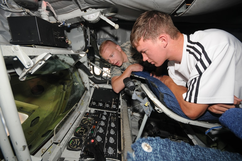 "Staff Sgt. Bradley Harris, 151st Air Refueling Wing, shows a student the inside of a KC-135 Stratotanker during a Freedom Academy tour of the Utah Air National Guard Base on Aug.6.  Freedom Academy is a week-long leadership camp designed for high school student body officers from schools throughout Utah.  It is hosted by members of the Utah Army and Air National Guard, and focuses on the theme of ""freedom.""  (USAF photo by Tech Sgt. Mike Evans)"