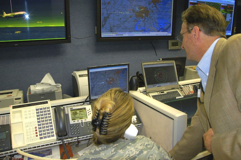 Larry Christie a leader of the Tyndall distributed mission team shows airmen how the virtual technology works to provide leaders information make critical decisions,