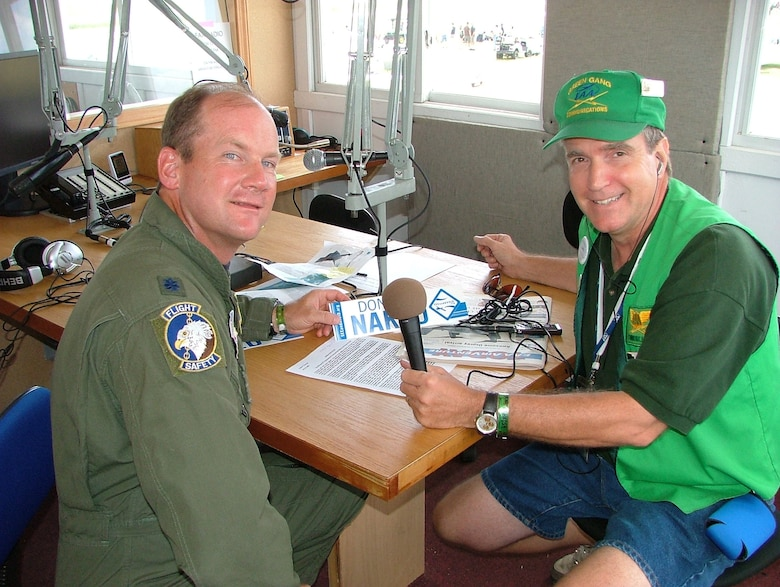 Rob Sturgeon, who also goes by Radio Rob, with Experimental Aircraft Association radio, interviews Lt. Col. Ned Linch, the 12th Air Force (Air Forces Southern) chief of flight safety during the   Experimental Aircraft Association Air Venture Oshkosh airshow in Oshkosh, Wisconsin where more than 540,000 civilians and military pilots from around the globe gathered July 31-Aug. 3 to showcase their planes and to compete for awards that recognize the best of the best.. The colonel is attending the airshow to educate general aviation and civilian pilots on midair collision avoidance and on the need for flight safety and planning awareness.