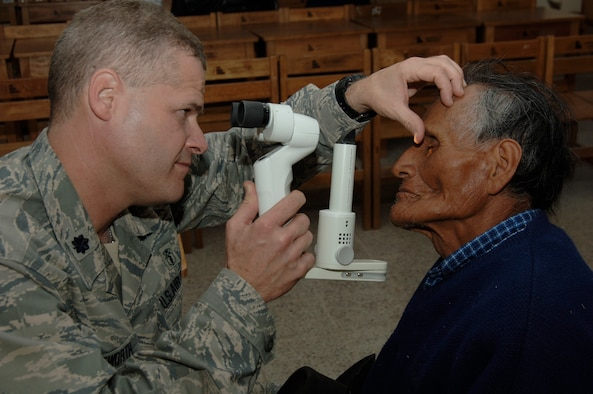Dr. (Lt. Col.) Gregg Wentworth, an optometrist from the 433rd Medical Group at Lackland AFB, Texas, performs an eye exam on a Peruvian man during a medical mission in Quinua, Peru, Aug. 7.  A team of 19 Air Force reservists deployed to Ayacucho, Peru to perform the last three medical missions supporting New Horizons - Peru 2008, a U.S. and Peruvian effort to bring relief to underpriviliged Peruvians. (U.S. Air Force photo/1st Lt. Mary Pekas)