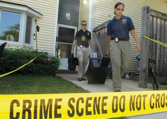 Special Agents Martha Ward and Bryan Schmelzer, Forensic Science Consultants, 2nd Field Investigations Squadron, AFOSI Region 7, depart from a house they used for training July 17. (U.S. Air Force photo/Senior Airman Renae L. Kleckner)
