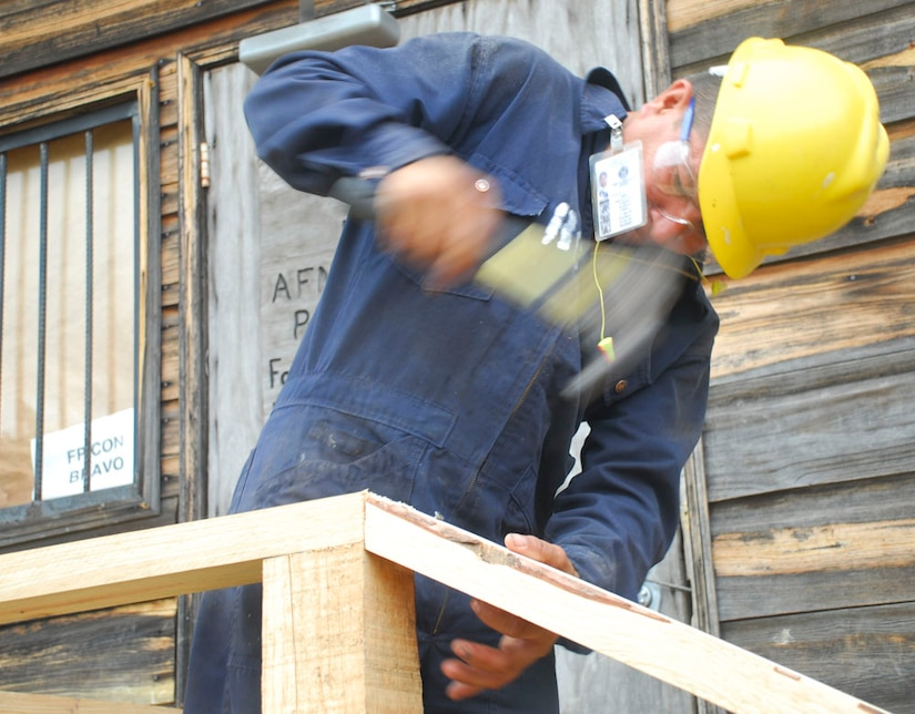 SOTO CANO AIR BASE, Honduras - A contractor builds a new set of stairs for a building at Joint Task Force-Bravo. Because JTF-Bravo is a temporary installation most of the buildings are made out of wood. Termites and weather conditions require the civil engineers to consistently replace the wood on the structures. (U.S. Air Force photo by Staff Sgt. Joel Mease)