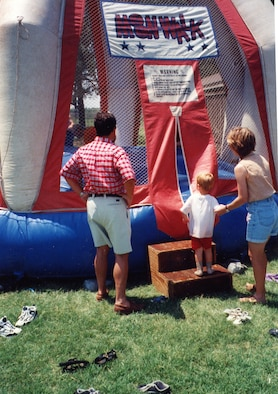 """A young family member steps up to an inflatable bouncer during one of the 931st Air Refueling Group's past Family Day picnics.  Volunteers are needed to help with an inflatable """"Bounce House"""" and many other activities scheduled for this year's picnic during the September Unit Training Assembly."""