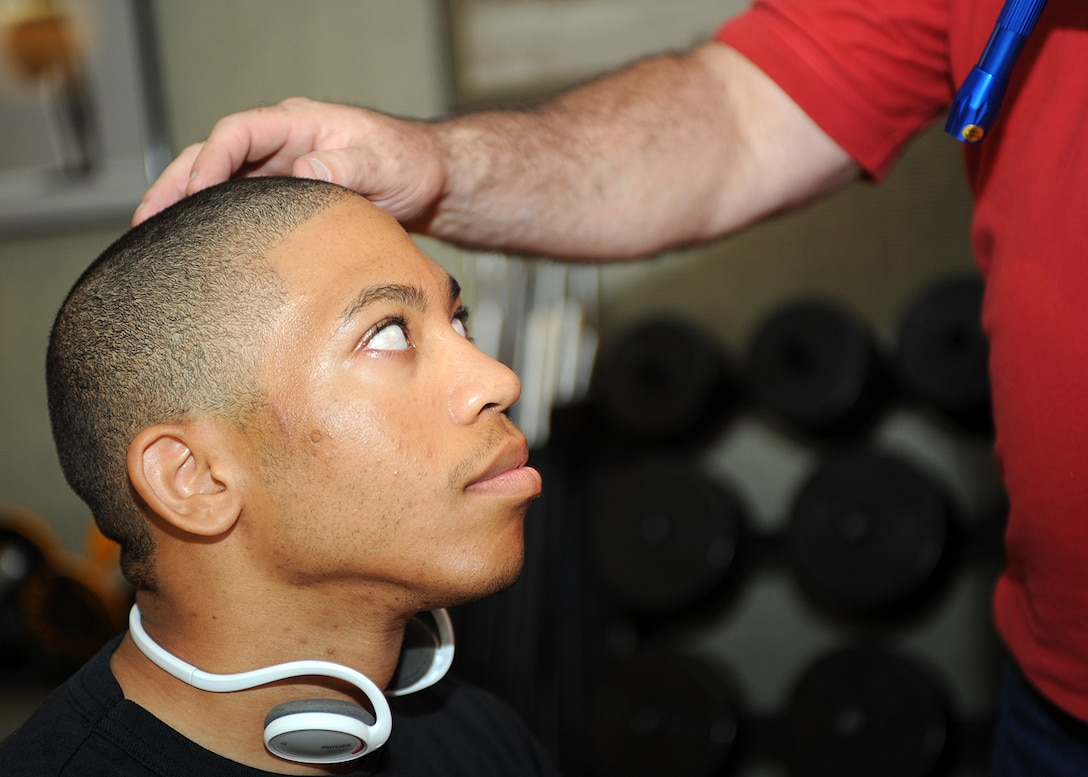 Airman 1st Class Willy Bivins, 49th Maintenance Squadron, receives a checkup for any coherency problems before his boxing match at the Border Rumble at Fort Bliss Army Post in El Paso, Texas, July 25. The Screening process is required before every fight. (U.S Air Force photo/ Airman 1st Class DeAndre Curtiss)