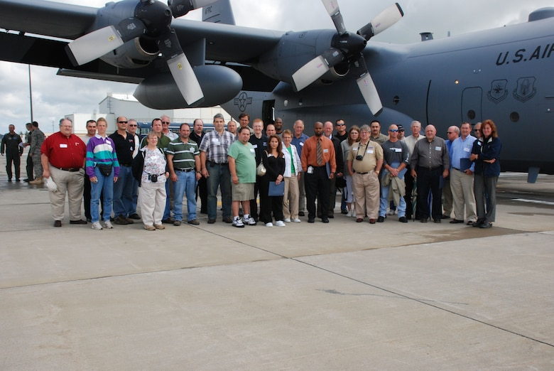 The moment will be forever etched in digital history for a group of local employers, prior to their flight of a life time the group gathered for a photo. Guardsman?s and reservist?s bosses had the opportunity to visit the Niagara Falls Air Reserve Station on the first joint 107th and 914th Bosses? Day held on Aug. 8. (Air Force Photo/ Master Sgt. Paul Brundage)