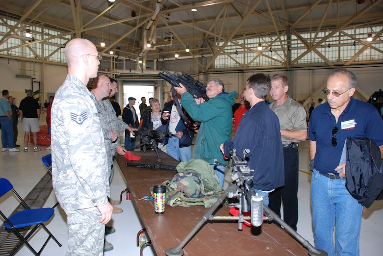 Bosses kept members from both the 107th and the 914th security forces busy all day. A display of numerous weapons was set up for the employers to ask questions, touch, pick and safely handle.(Air Force Photo/ Master Sgt. Paul Brundage)