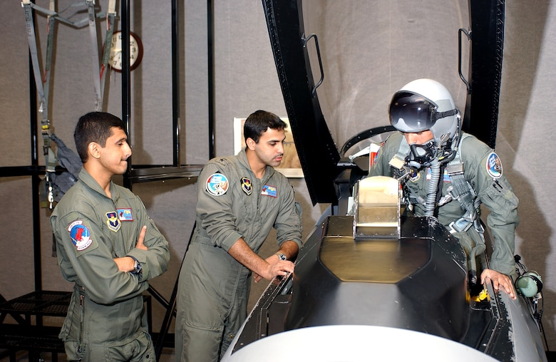 Three student pilots from the United Arab Emirates practice emergency egress procedures as part of their F-16 flight training at the 162nd Fighter Wing in Tucson, Ariz. The Air Guard unit has trained foreign pilots since 1989. (Air National Guard Photo by Master Sgt. Dave Neve)