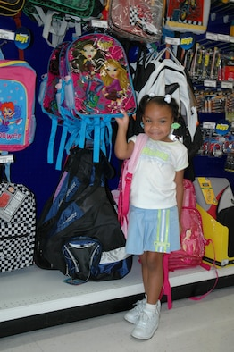"With school starting Monday for most Brevard County students, Matyce Tapper, 4-years old and starting pre-school, shows off the new backpack she picked up at the Patrick BX last week. AAFES officials want to remind shoppers that they have many discounted items at the store, to include lunch boxes, backpacks, shoes and more. ""AAFES' buying staff has done its homework over the past year and we're ready to pass the savings lessons on to authorized shoppers,"" said the exchange's Teo Smith, General Manager. ""Even though we've crammed to deliver the best 'back to school' shopping experience possible, we're always prepared to match the lowest local price to ensure military Families are getting the best value for their 'back to school' dollars."" (U.S. Air Force photo by Airman 1st Class David Dobrydney)"
