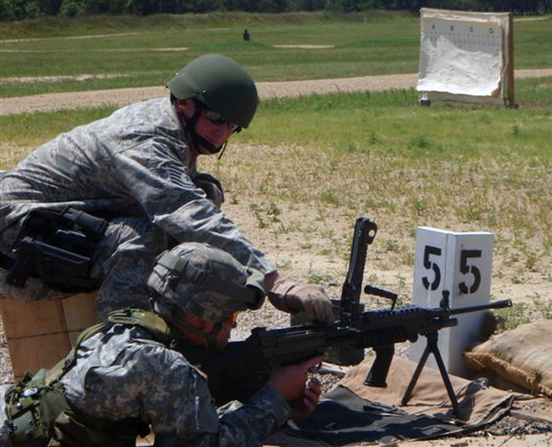 Tech. Sgt. Adam Moore, 183rd Security Forces Squadron Combat Arms Training & Maintenance, assists the Army with M-249 qualifications.  Members from 131st Security Forces Squadron helped train four Army units on weapons for an upcoming deployment.