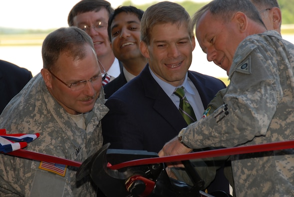 (listed left to right) Assistant Adjutant General, Ohio Army National Guard, Brigadier Matthew L. Kambic; Vice President of Goyal Industries, David Howard; Ohio (Dem) 73rd District State Representative Jay Goyal; Ohio (Rep) 4th District Congressman Jim Jordan; 179th Airlift Wing Commander, Colonel Mark L. Stephens and Adjutant General of Ohio Joint Force Headquarters, Major General Gregory L. Wayt at the ribbon cutting ceremony for the new Army Guard Fire Station at Mansfield Lahm Airport, Mansfield, Ohio on May 30, 2008. The occasion marked the first Army Guard installation at the Mansfield Lahm Guard Base which has only been an Air National Guard base since opening in 1948. (U.S Air Force photo by A1C Joseph Harwood) (Released)